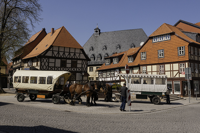 Two horse-drawn carriages by the flower clock on the Marktstraße, Wernigerode